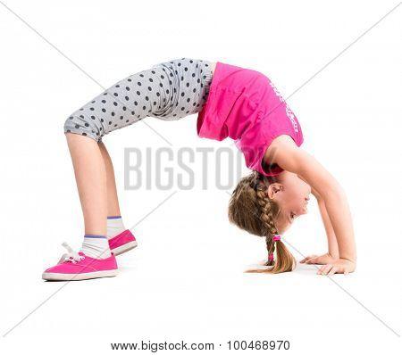 little girl doing the bridge exercise isolated on white background