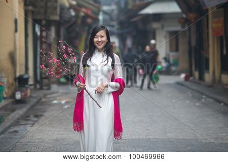 Vietnamese girl in traditional dress (ao dai) in Hanoi ancient town.