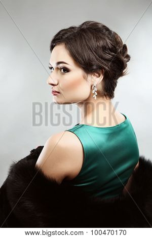 Retro style portrait of young woman on light background