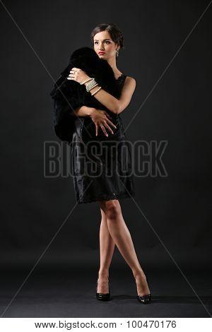 Retro style photo on pretty woman on dark background