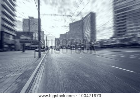 Blurred Picture Of The Wide Street.