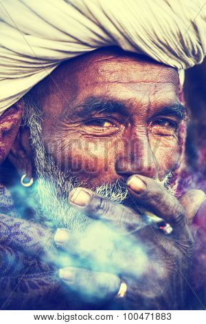 Indigenous Indian Man Smoking Happily Concept
