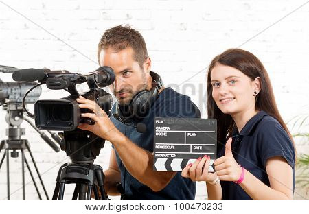 A Cameraman And A Young Woman