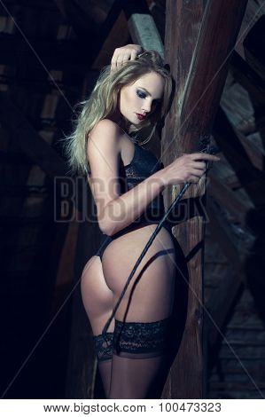 Sexy Blonde Woman Posing With Whip In Barn