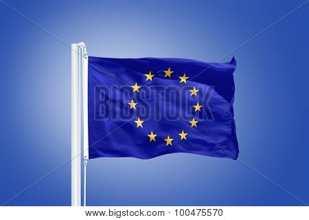 European Union flag on blue sky background.