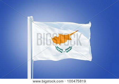 Flag of Cyprus flying against a blue sky.