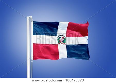 Flag of Dominican Republic flying against a blue sky.