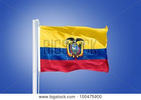 Flag of Ecuador flying against a blue sky.