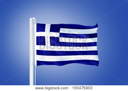 Flag of Greece flying against a blue sky.