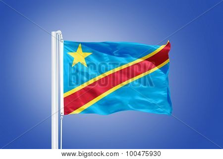 Flag of Congo flying against a blue sky.