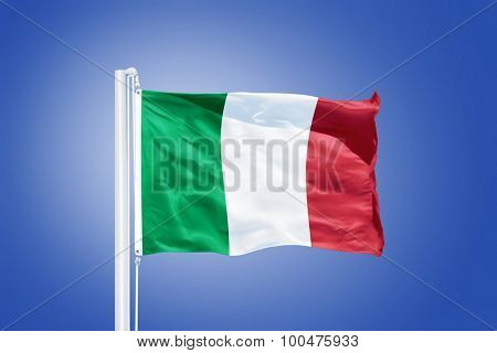Flag of Italy flying against a blue sky.