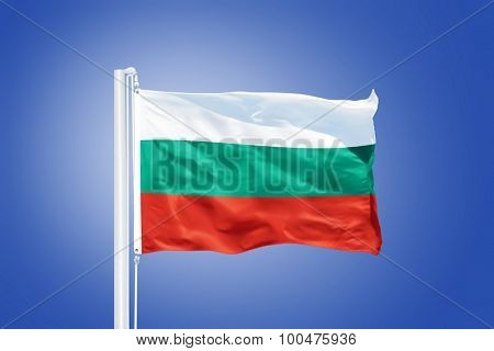 Flag of Bulgaria flying against a blue sky.