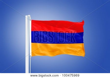 Flag of Armenia flying against a blue sky.