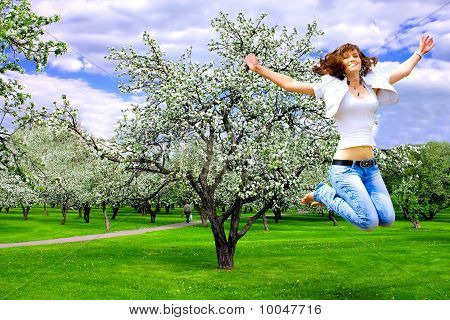 pretty girl with open hands in spring rural park