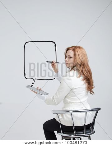 woman writes in a painted speech bubble