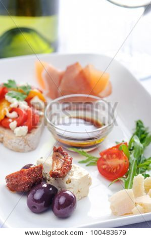 Antipasto; olives and sundried tomato, parma ham with rockmelon, toast with roasted mixed peppers and feta cheese, cubes of cheese and salad