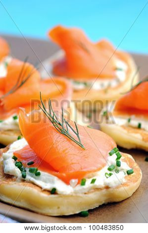 Platter of bite size smoked salmon appetisers canapes suitable for a party