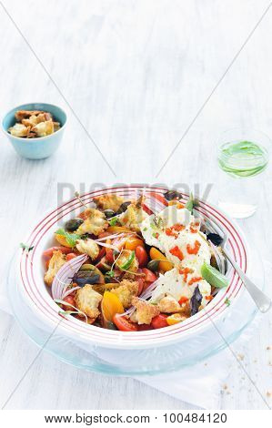 Salad with tomatoes and mozzarella with fresh basil, capers and onion