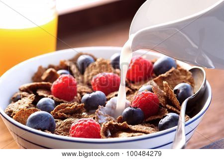 Healthy breakfast with milk and fresh fruit