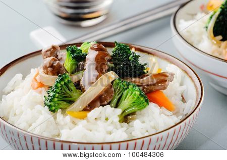 Thai dish beef stir fry with vegetables on white rice