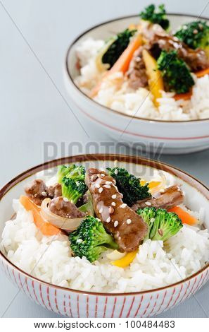 Oriental chinese beef stir fry with vegetables on white rice