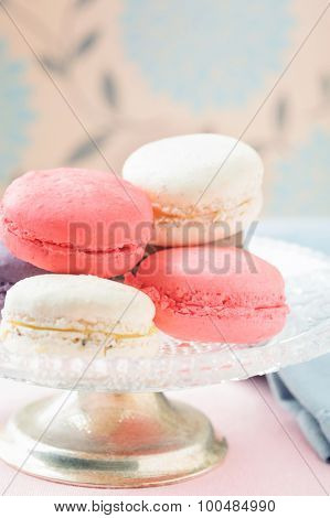 Assorted macaroons on vintage plate, close up shallow depth of field