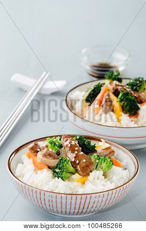 Thai or chinese dish beef stir fry with vegetables on steamed white rice