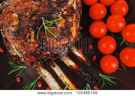 grilled ribs with cherry on dark plate