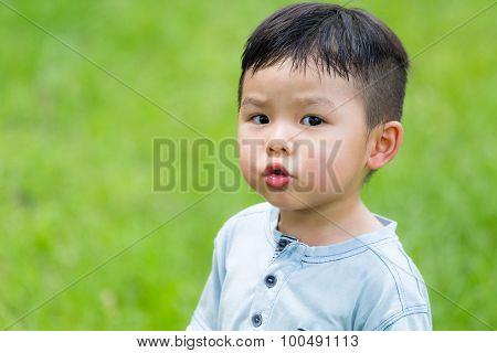 Little boy pout lip