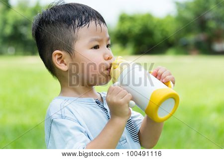 Little boy drink with his water bottle