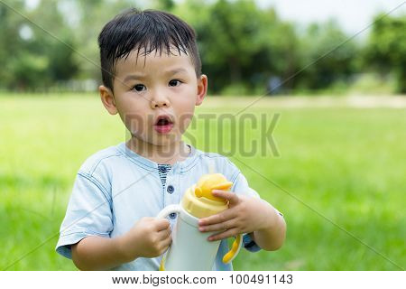 Little boy hold with his water bottle