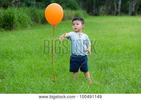 Asian Little boy release his balloon