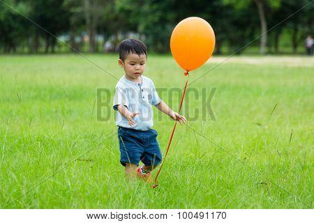 Asian little boy play with balloon