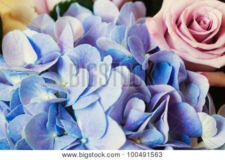 Blue Hydrangea and purple rose