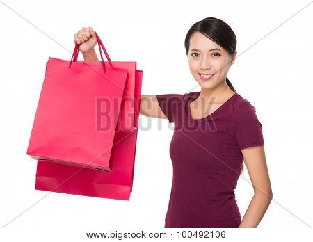 Asian woman holding with red shopping bag