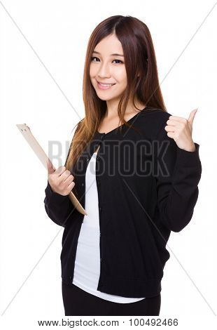 Young woman hold with clipboard and thumb up