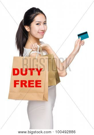 Woman with credit card and holding shopping bag for showing duty free