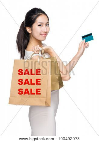 Woman with credit card and holding shopping bag for showing three sale word