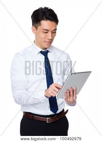 Asian businessman use of the tablet pc