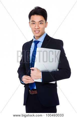 Young businessman hold with notebook computer