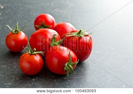 red tomatoes on kitchen table