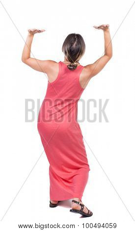 back view of woman  protects hands from what is falling from above.Rear view people collection.  Isolated over white background. Girl in red long dress is holding something over your head.