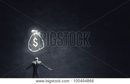 Businessman with hands spread apart and dollar sign above
