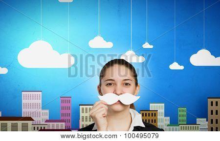 Happy cute girl trying male paper mustache