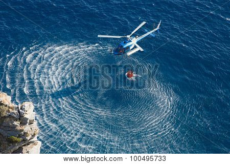 Fire fighter helicopter collect water over the sea