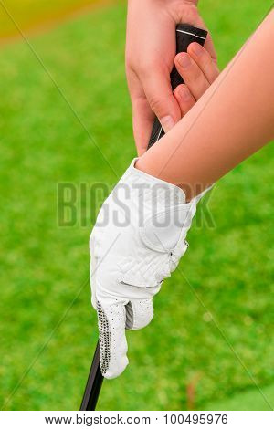 Hand With White Gloves Holding Golf A Putter