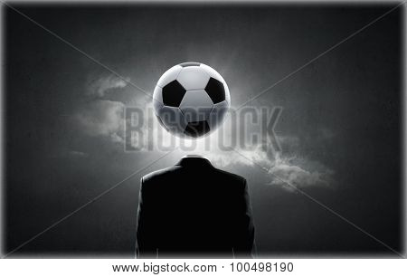 Unrecognizable man with soccer ball instead of head