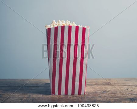 Popcorn On Wooden Table