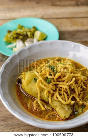 Thai Noodle Curry Soup With Chicken On Wooden Table