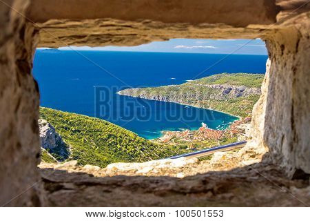 Komiza Bay Aerial View Through Stone Window